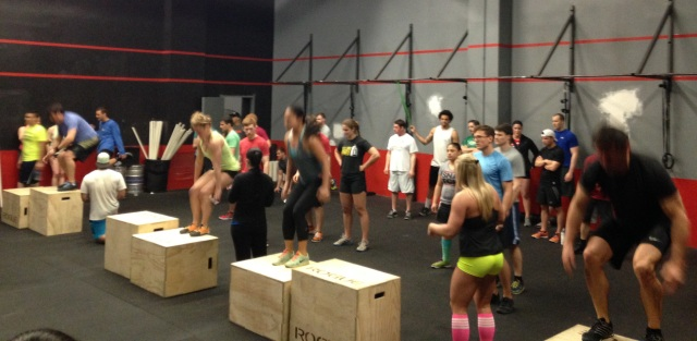 Teams from the 2nd heat working on the burpee box jumps
